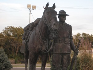 """Fort Riley was home to the African-American cavalry troops known as the """"Buffalo Soldiers.""""  Just outside of post, in Junction City, is a monument dedicated to the Buffalo Soldiers.  My first unit in Korea, back in 1988, traced its lineage to the Buffalo Soldiers.  We used to sing the Bob Marley song of the same name at the top of our lungs in the bars outside our post."""